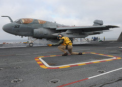 A Lt. Cmdr. gives the pilot of a Prowler the signal to launch off the flight deck. (Official U.S. Navy Imagery) Tags: pacificocean ussnimitz aricraft cvn68 ea6bprowler rimpac vaq142 rimofthepacific