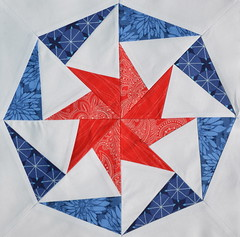 Block for janesfabrics (jenjohnston) Tags: blue red star pinwheel quiltblock paperpieced quiltingbee