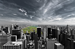 Green lung of the city (Michel Couprie) Tags: park city nyc trees roof sky usa lake newyork green rooftop clouds forest canon eos cityscape centralpark manhattan rockefellercenter topoftherock skyscrapper buidings lung 450d selectivecolors 100commentgroup