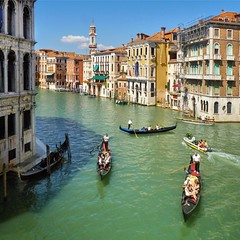 The Grand Canal in the heart of Venice (Bn) Tags: venice gondola rowing gondolier color richness venetian shift hue italian renaissance reflection red orange yellow shade venezia veneti world heritage site unesco river boats island canals beauty ancient pedestrian vaporetti taxis ride trip italia italy itali mirror shoreline tourist taxi summer sun warm weather islands colorful houses life voyage street travel windows people music city light sea water europe explore palaces history texture rialto bridge grand canal 50faves topf50