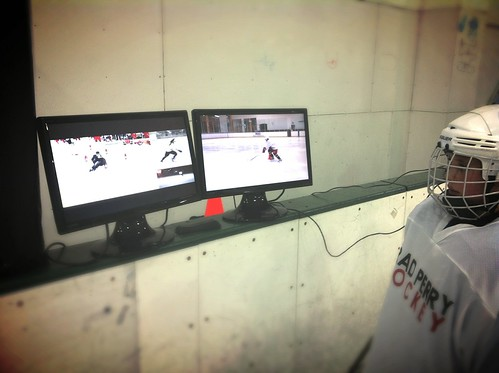 Brad Perry hockey video analysis session on ice