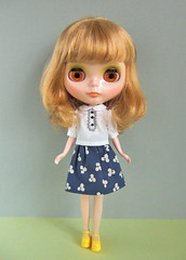 white blouse and sumile skirt