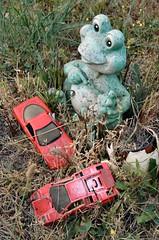 Froggy (runran) Tags: cemeteries cemetery grave graveyard car yard toys bc britishcolumbia frog vancouverisland duncan froggy gravemarker stannschurch redsportscar quamichan