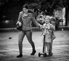 A Free Ride (Just Ard) Tags: street venice people blackandwhite bw italy woman white black blancoynegro monochrome smile face children person photography 50mm mono nikon eyecontact ride noiretblanc zwartwit candid scooter d750 unposed  biancoenero schwarzundweis justard