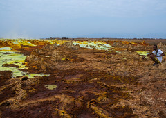 The colorful volcanic landscape of dallol in the danakil depression, Afar region, Dallol, Ethiopia (Eric Lafforgue) Tags: africa travel lake man color male tourism nature beauty horizontal outdoors volcano spring colorful day desert natural earth acid horizon surreal formation serenity heat minerals environment sulphur geography geology ethiopia hotspring volcanic saline geothermal arid oneperson hornofafrica afar eastafrica geological abyssinia onlymen fulllenght onemanonly 1people afarregion dallol danakildepression oneadultonly ethio161975