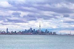 View of Downtown Toronto (A Great Capture) Tags: city blue sky urban cloud white lake toronto ontario canada water windmill skyline clouds buildings lights spring downtown photographer cntower overcast canadian smokestack lakeontario springtime on agc 2016 jamesmitchell adjm wwwagreatcapturecom agreatcapture mobilejay