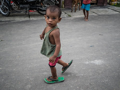 (milan syangbo) Tags: nepal eye kid eyecontact streetphotography streetlife olympus slippers colourphotography 17mm olympusomdem10