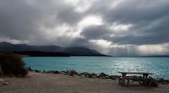 Glacial Flour Waters (Jocey K) Tags: autumn newzealand mountains water clouds bench landscape scene hills southisland centralotago skys lakepukaki tripdownsouth mackenziebasin glacialfeedlake