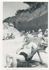 at the beach (mel's old ads and mags) Tags: shirtless people blackandwhite man male sol praia beach vintage sitting areia tan sunny shore oldphoto speedo swimsuit homem pretoebranco foundphoto tanning bathingsuit swimwear senhor vintagephoto unknownyear fotoantiga semcamisa vintagebeach vintagepicture vintagescan vintagefun vintagesnapshot