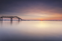 hazy shades of summer (dK.i photography) Tags: longexposure morning bridge summer color industry water sunrise reflections baltimore minimal negativespace pastels chesapeakebay keybridge truss hss patapscoriver softcolors dwan ftarmistead bigstopper sliderssunday