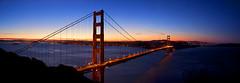 Golden Gate Bridge (Leighton Wallis) Tags: sanfrancisco california birthday ca city blue red orange usa tower cars water sunrise dawn lights bay unitedstatesofamerica goldengatebridge cables baybridge alcatraz therock suspensionbridge sutrotower internationalorange 75thanniversary marinheadland ggnpc11