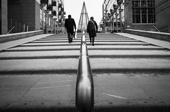Business As Usual.. (Peter Levi) Tags: street city blackandwhite bw woman man blancoynegro stairs sweden stockholm streetphotography x100 dblringexcellence tplringexcellence fujifilmx100 fujix100 fujifilmfinepixx100 asquaresuperstarstemple eltringexcellence