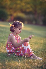 (Rebecca812) Tags: family sunset portrait orange cute green girl childhood kid sitting child dress sweet hill innocent daughter thoughtful pensive pigtails clover sideview seated idyllic floralprint sundress lookingaway fiveyears grassyhill hairribbon canon5dmarkii rebecca812