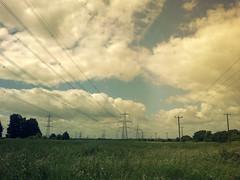 Cloudy (Matt_Pugh) Tags: blue trees sky white colour tree green grass southwales wales clouds grey cymru pylon clear welsh 2012 e500 caldicot mygearandme