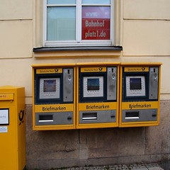 Munich stamp vending machines (Monica Arellano-Ongpin) Tags: yellow germany munich amarillo gelb giallo munchen postalstamps briefmarken monacodibaviera timbres francobolli