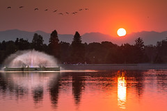 Denver's City Park Sunset (glness) Tags: sunset fountain geese haze colorado denver fires citypark gregness