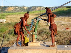 Himba repairing a water pump (Namibia Red Cross Society) Tags: africa red water humanity safe waterpump namibia humanitarian redcross sanitation himba hygeine safewater
