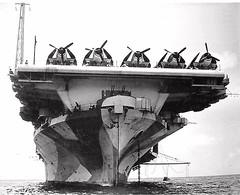 USS Hornet CV 1944. Grumman F6F Hellcats parked on the carrier's flight deck and anti-aircraft gun.