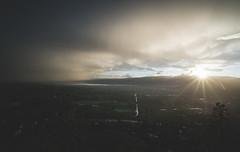 Rainy Sunset (eric.vanryswyk) Tags: light sunset sky cloud sun mountain lake canada storm mountains wet water rain weather clouds landscape dawn twilight nikon exposure moody dusk stormy columbia rainy valley kelowna 20mm nikkor f18 d610 briitsh