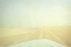 Sandy Mad Dogs IV (Doha Sam) Tags: slr 35mm nikon jon kodak scan negative sandstorm 400 analogue wilderness fe portra manualfocus qatar nissanpatrol sealine nikonscan filmiso400 coolscan9000ed southerndesert newportra samagnew smashandgrabphotocom linearscan wwwsamagnewcom