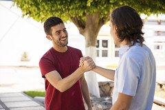 Giving a handshake at school (reputationtempe) Tags: park school friends two man male guy college smile youth fun happy student education university friendship outdoor pair young handsome diversity lifestyle meeting blond latin handshake casual hispanic copyspace youngadult facetoface bros greeting hangingout 20s