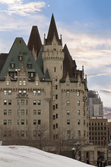 Ottawa, Canada - February 05, 2016: View of Fairmont Chateau Laurier from the Parliament Hill, Ottawa, Canada. This castle is named for Sir Wilfred Laurier, the former Prime Minister of Canada. (Alma de Angel) Tags: old city roof winter party summer people sculpture brown holiday snow ontario canada cold color building green castle tourism window horizontal stone architecture clouds america landscape outside outdoors hotel evening leaf maple beige triangle downtown day cityscape exterior ottawa side capital crowd profile nobody landmark canadian crest historic clear copper limestone elegant chateau laurier festivities luxury turret fairmont attraction chateaulaurier revelers balconymcopyspace