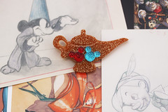 Brooches by Jolly Hollieday (jollyhollieday) Tags: disney disneyland handmade jewelry brooches pins magic kingdom walt brooch macro glitter sparkle jolly hollieday hollie day lamp genie aladdin mickey d movies entertainment pin cards etsy