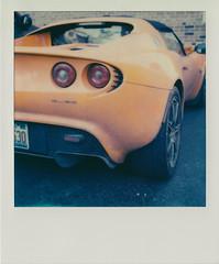 Lotus Elise, rear (DavidVonk) Tags: orange film sports car analog vintage polaroid lights lotus elise tail engine tire instant slr680 mid s2 roadster convertable series2