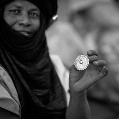 Portrait of a Tuareg tribesman showing a ring, Ghadames, Libya (Eric Lafforgue) Tags: africa blackandwhite man male sahara festival square outdoors desert northafrica unescoworldheritagesite berber nomad grainy turban libya oneperson jewel touareg bedouin onepeople traditionalculture ghadames libia libye traditionalclothing colorimage blackskin libyen lookingatcamera onemanonly lbia italiancolony artscultureandentertainment indigenousculture libi libiya tripolitania  ribia twareg liviya imuhagh ghadamis gadhames ghudamis libija nomadicpeople  tagelmust      lbija  lby  libja lbya liiba livi  fezzanprovince nomadicpastoralist a0013993