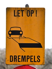 Car encounters an obstacle (Michiel2005) Tags: auto car sign warning bord verkeersbord waarschuwing drempel