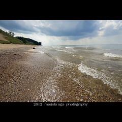 Sand and Pebbles ... (mariola aga) Tags: summer sunlight lake beach water clouds square sand waves dunes shoreline indiana wideangle pebbles lakemichigan rays sunrays sparkling indianadunes thegalaxy