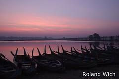 Amarapura - U Bein Bridge at dawn (Rolandito.) Tags: morning bridge boats dawn boat burma silhouettes bein u myanmar dämmerung birma mandalay amarapura birmanie birmania