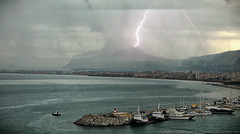 Palermo Lightning Strike (Chris Lafort) Tags: italy storm mountains rain weather clouds boats bay harbor stormy sicily lightning palermo lightningstrike colorefex viveza panasonictm700