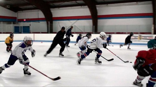 Brad Perry skating with students at a hockey school in Chicago