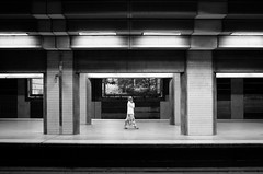 Framed.. (Peter Levi) Tags: street city blackandwhite bw woman blancoynegro sweden stockholm streetphotography documentary trainstation subways x100 walkingwoman streetminimalism fujifilmx100 fujix100