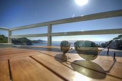 Sunglasses View (ebalch) Tags: blue sky sun reflection sunglasses table hotel glasses nikon balcony croatia shades rays dubrovnik adriatic rayban hotelbellevue d5100 ebalch adriaticluxury