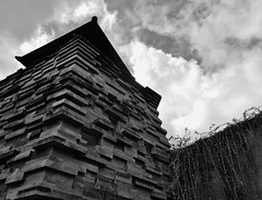 Rapunzel's tower (SM Tham) Tags: windows sky blackandwhite bali plant building tower monochrome stone wall architecture clouds indonesia outdoors island hotel asia belltower resort creepers sanur kulkul budimanhendropurnomo mayasanurresortspa dentoncorkermarshalljakarta