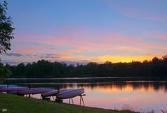 Canoes at dusk (AllTheGoodIDsAreTaken) Tags: sunset sky lake reflection water clouds dusk canoes