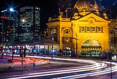Flinders Street Station at Night | Melbourne, Australia (Faithful Freja) Tags: longexposure orange station yellow night movement traffic melbourne vehicles trainstation intersection flindersstreet cityofmelb