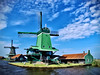 De Gekroonde Poelenburg. (tetleyboy) Tags: explored windmill netherlands historicalbuilding landscape sawmill building framed blue green facebook old cloud sky polder grass water dyke canal wooden traditional gimp dreamsmoothing gmic