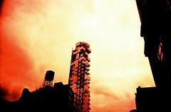 Space. (UrbaceousSentiment) Tags: nyc newyorkcity film analog skyscraper lomo lca xpro crossprocessed watertower slide analogue pushed vignetting watertank wasserturm hochhaus diafilm vignettierung