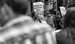 One for Donald (Just Ard) Tags: man woman protest protestors placards banners shoulder beard hat people person face street photography candid unposed black white mono monochrome bw blackandwhite noiretblanc biancoenero schwarzundweis zwartwit blancoynegro  justard nikon d750 85mm