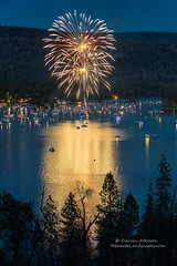 Twins over Bass Lake (Darvin Atkeson) Tags: california light lake snow mountains reflection water rain forest day glow fireworks bass nevada 4th july sierra pines shore independence 4thofjuly basslake oakhurst elnino 2016 darvin atkeson darv lynneal yosemitelandscapescom