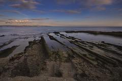 Le rocce di Punta della Mola (Andrea Rapisarda) Tags: sea italy seascape beach sunrise landscape nikon rocks italia mare ngc sigma sicily spiaggia sicilia siracusa nationalgeographic sigma1020mm d7000