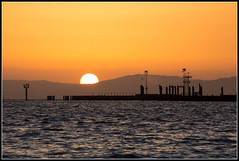 The Land of the Sinking Sun (Morrow Cove) Tags: california sunset usa sun mountains water canon landscape evening bay amber dock haze waves photographer unitedstates vallejo strait sanpablo waterscape mareisland mountainrange sinkingsun 60d canoneos60d crystalpointe