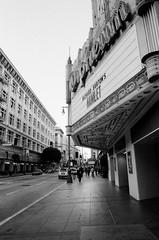 (Terrini) Tags: life street city urban blackandwhite film analog photography losangeles theater downtown 35mmfilm analogue nikkor ilford orpheum delta400 nikonfg 24mmf28ais digitalscans richardphotolab