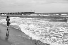 By the sea (Elios.k) Tags: sea blackandwhite italy white black reflection beach water girl horizontal walking outdoors pier focus dof walk wave shore tuscany oneperson foreground fortedeimarmi