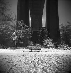 Silent nights (Zeb Andrews) Tags: park winter urban snow film night oregon dark square portland holga footprints kodaktrix pdx sjb stjohnsbridge cathedralpark bluemooncamera