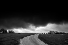 Dark sky, bad road (PeterSundberg66 former PeterSundberg65) Tags: road trees sky bw white black nature grass sweden dramatic falkping