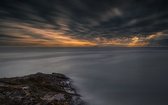 Waiting Out The Light [EXPLORE #6: 6/20/16] (Wilkof Photography) Tags: ocean california ca longexposure light sunset shadow sea sky seascape beach nature wet water canon dark lens landscape outside evening coast seaside rocks colorful surf waves waterfront sundown cloudy horizon perspective scenic rocky windy overcast panoramic boulder malibu pacificocean socal le shore nd land coastline southerncalifornia beachfront volcanicrock 18mm pointmugu oceanfront oceanscape neutraldensity 18135mm 10stop nd1000 canont4i wilkofphotography